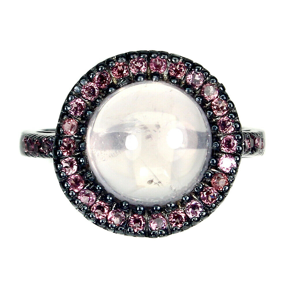 A 925 silver ring set with cabochon cut rose quartz pink sapphires, (R).