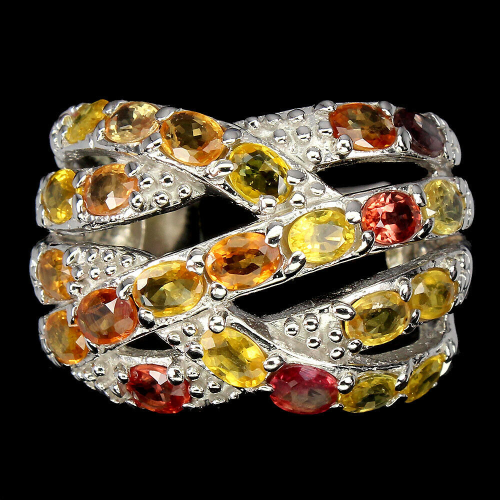 A 925 silver ring set with oval cut fancy sapphires, (P.5).