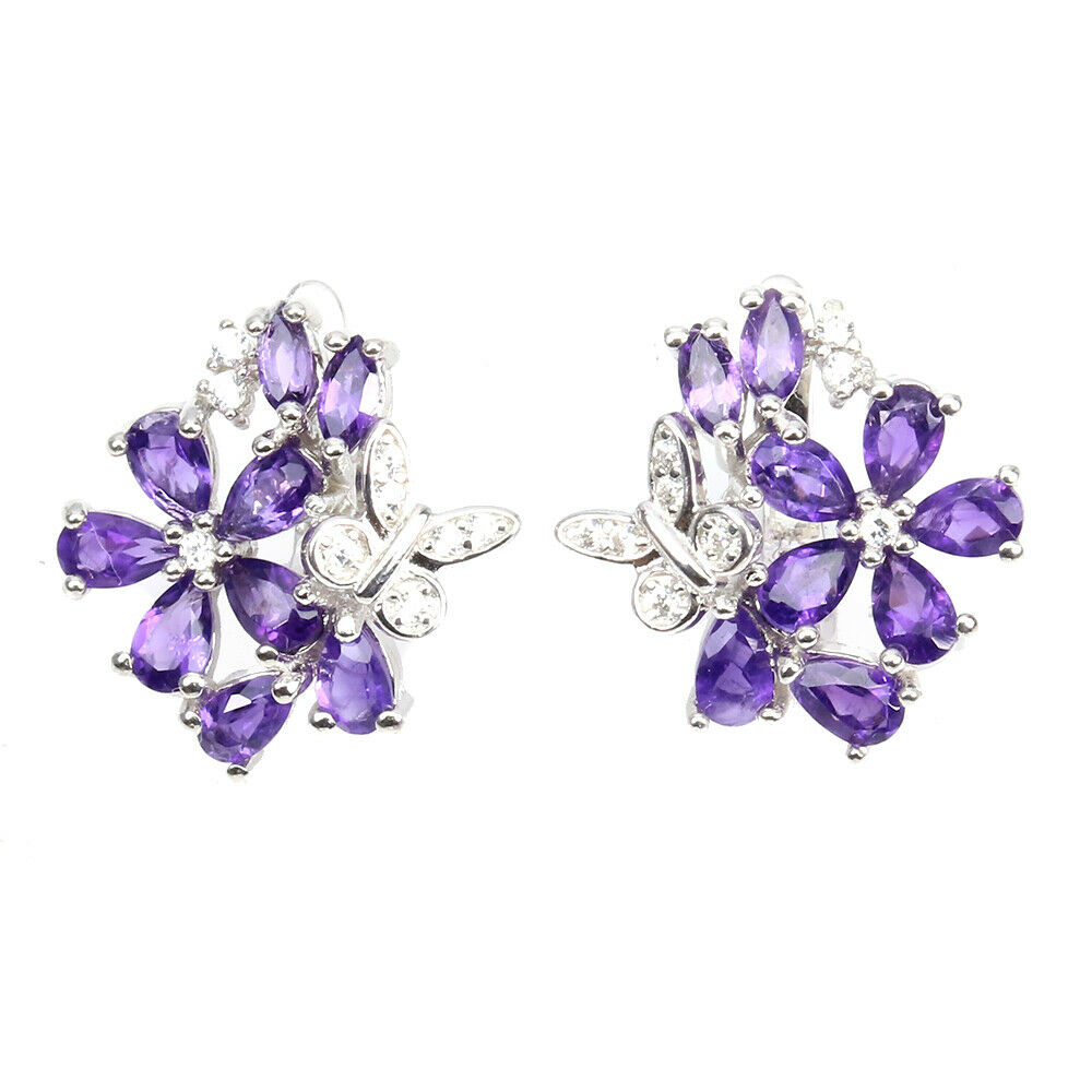 A pair of 925 silver flower shaped earrings set with pear cut amethyst and white stones, L. 2cm.