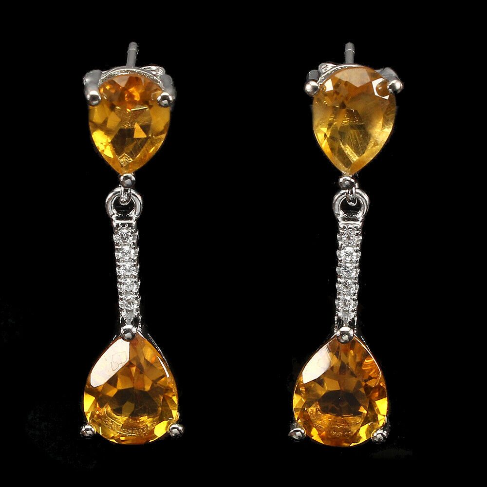 A pair of 925 silver pear cut citrine and white stone set drop earrings, L. 2.5cm.
