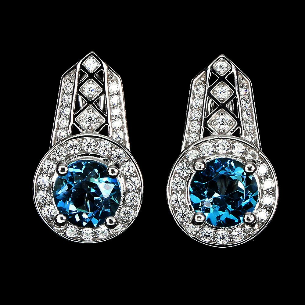 A pair of 925 silver earrings set with round cut London blue topaz and white stones, L. 2cm.