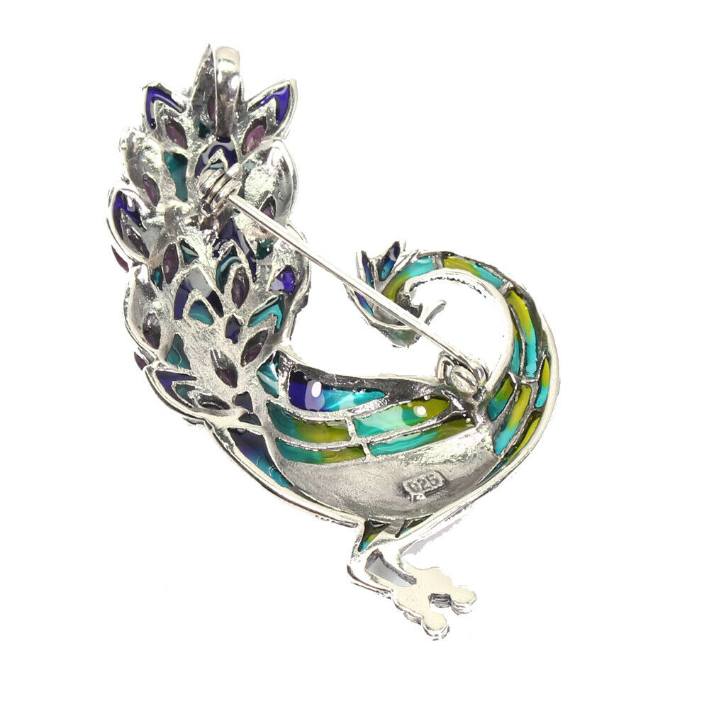 A peacock shaped 925 silver and marcasite enamelled brooch / pendant set with rubies, L. 6cm. - Image 2 of 2