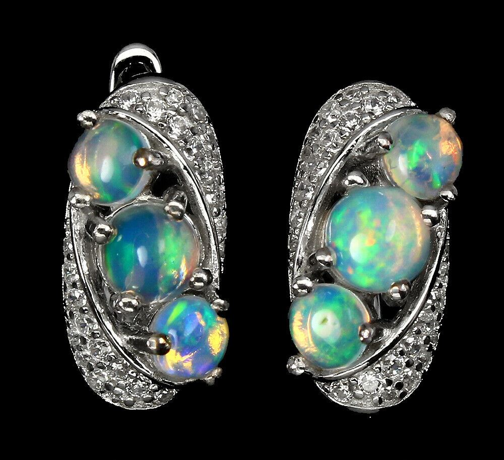 A pair of 925 silver earrings set with cabochon cut opals and white stones, L. 1.6cm.