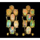 A pair of 925 silver gilt earrings set with cabochon cut opals, L. 2cm.