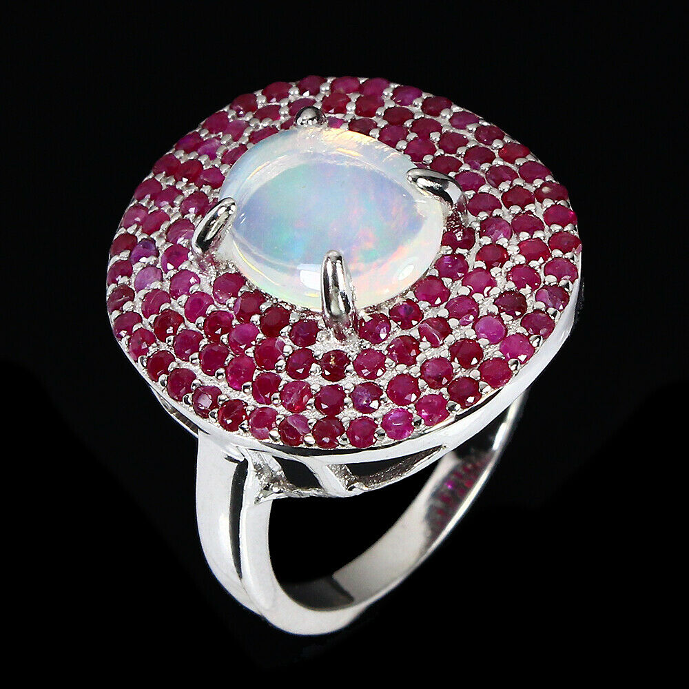 A 925 silver cluster ring set with a cabochon cut opal and two rows of rubies, (N). - Image 2 of 2