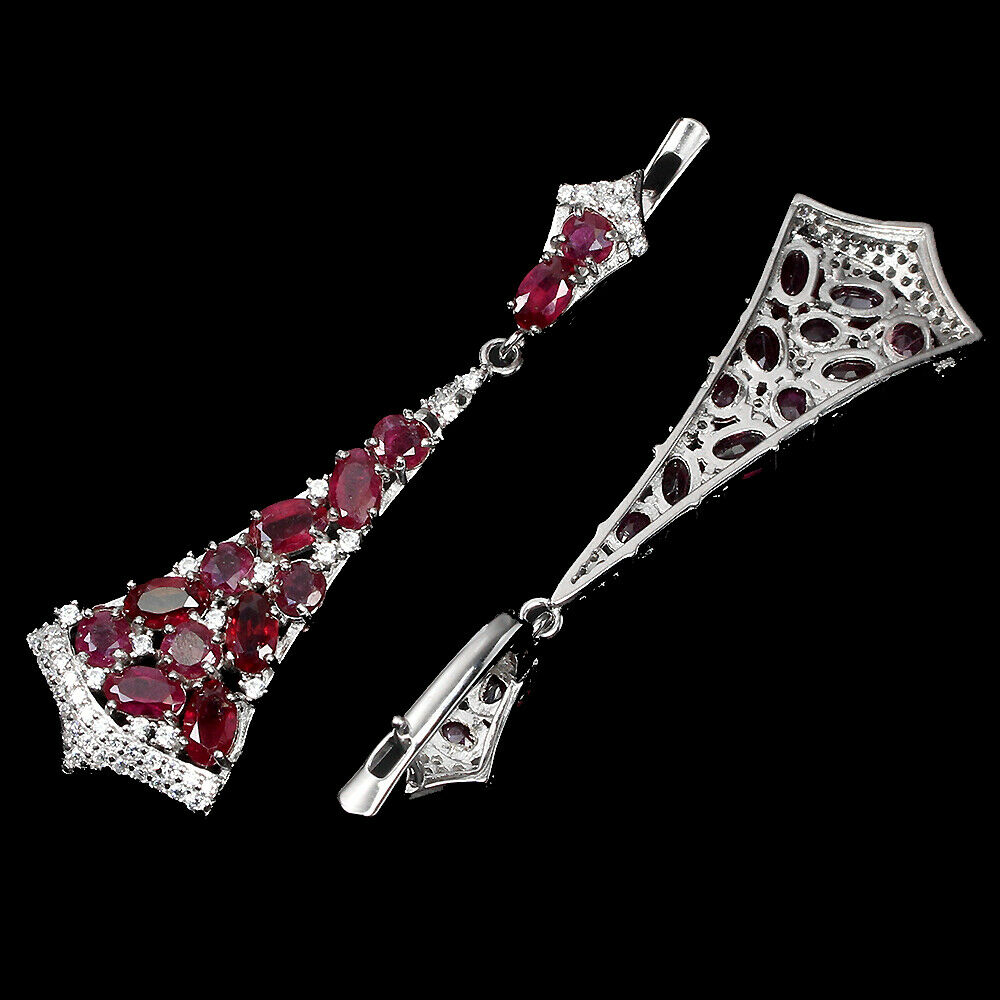 A pair of 925 silver drop earrings set with oval cut rubies and white stones, L. 5cm. - Image 2 of 2