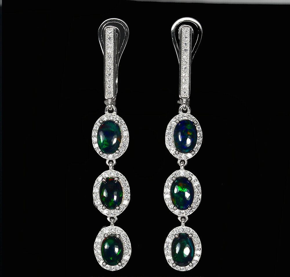 A pair of 925 silver drop earrings set with black opals surrounded by white stones, L. 4.8cm.