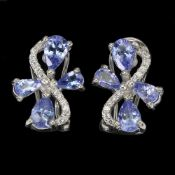 A pair of 925 silver earrings set with pear cut tanzanites and white stones, L. 1.5cm.