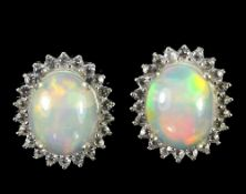 A pair of 925 silver opal and white stone set cluster earrings, L. 1cm.