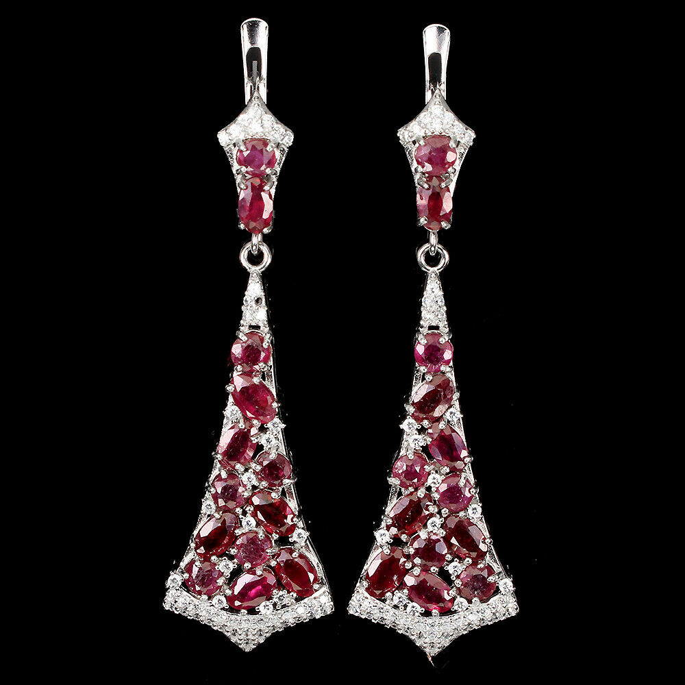 A pair of 925 silver drop earrings set with oval cut rubies and white stones, L. 5cm.