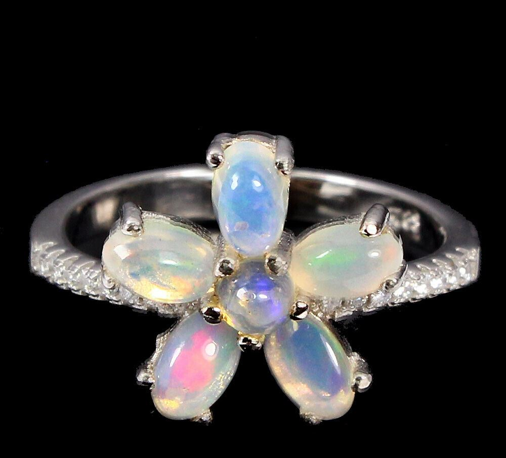 A 925 silver opal and white stone set ring, (O).