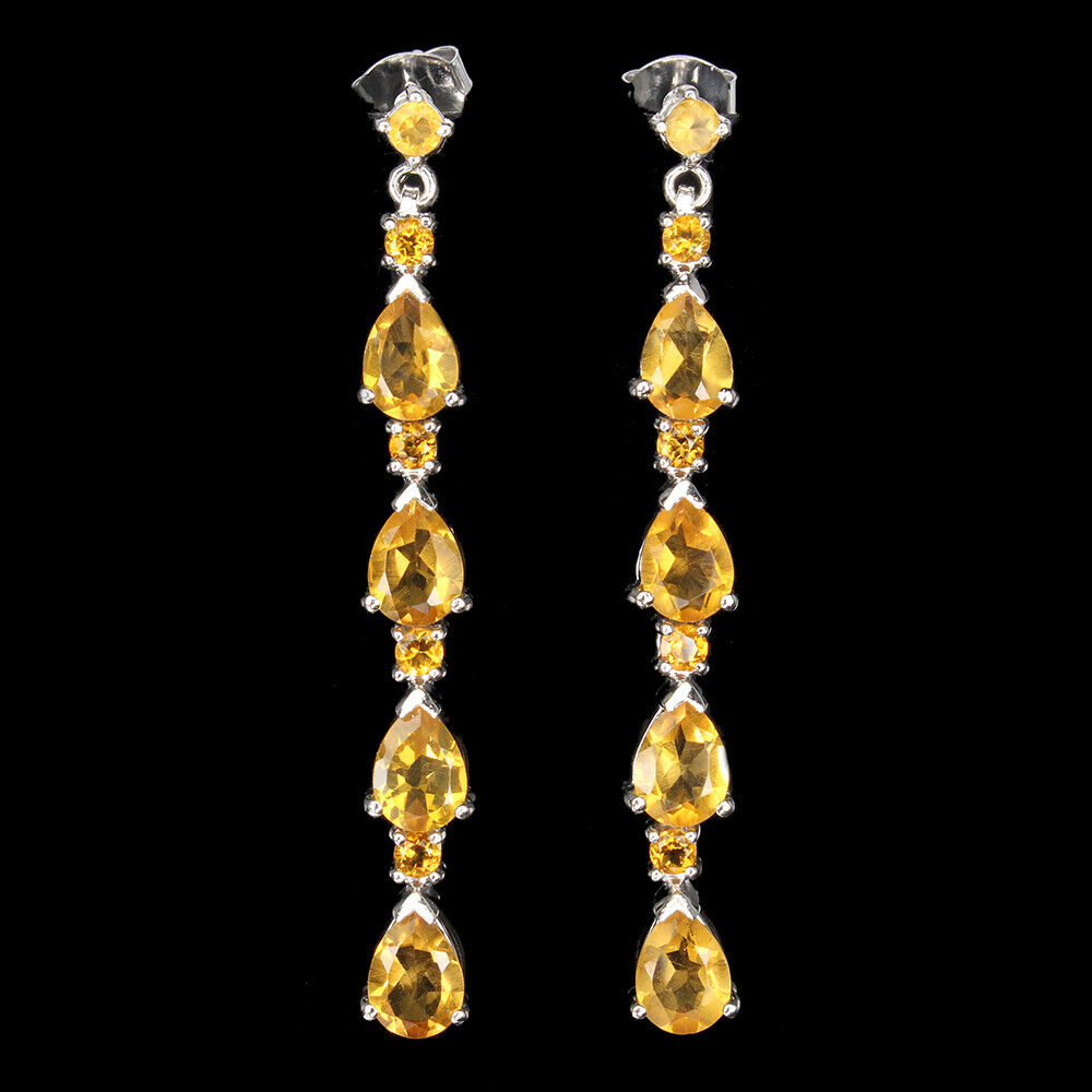 A pair of 925 silver drop earrings set with pear and round cut citrines, L. 5cm.
