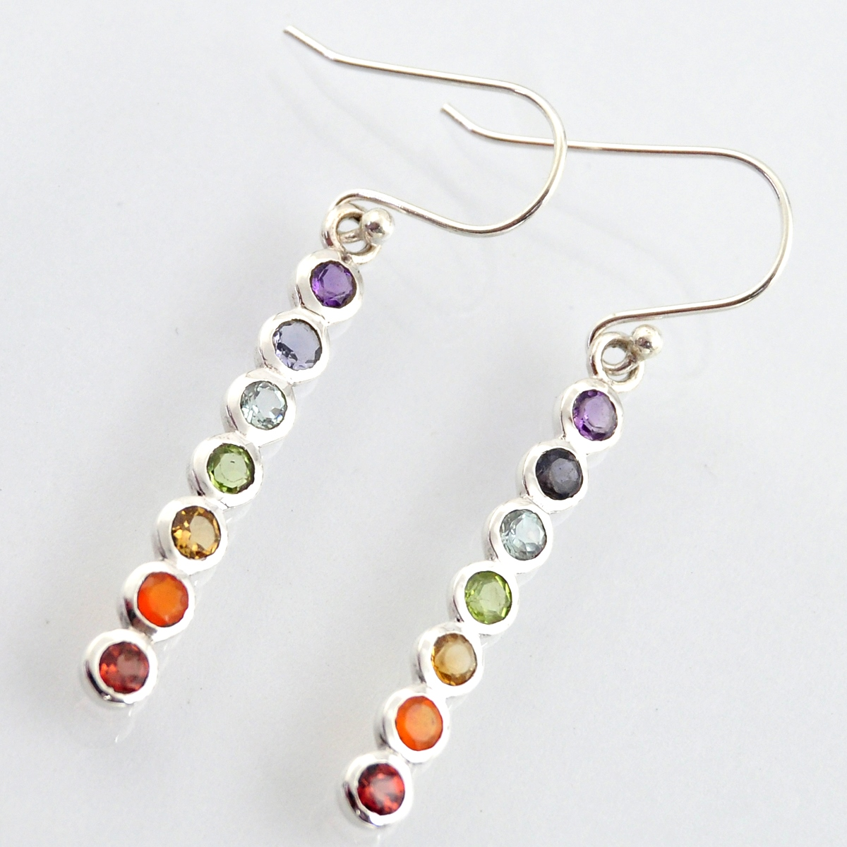 A pair of 925 silver rainbow drop earrings set with amethyst, iolite, topaz, peridot, citrine,