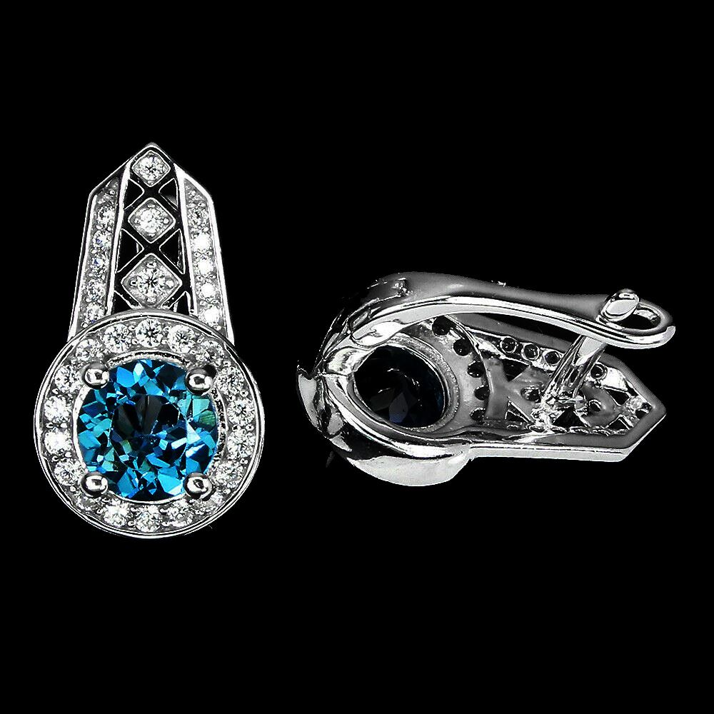 A pair of 925 silver earrings set with round cut London blue topaz and white stones, L. 2cm. - Image 2 of 2