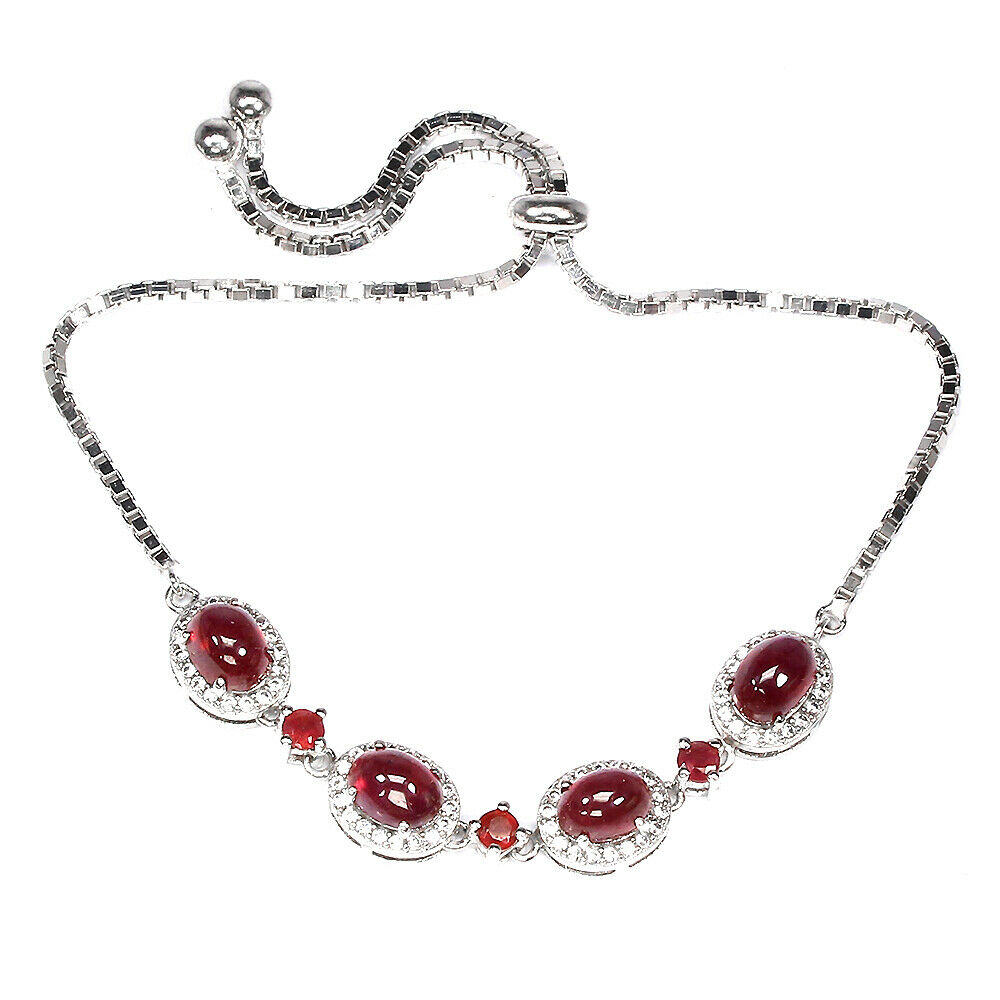 A 925 silver adjustable bracelet set with cabochon cut rubies.