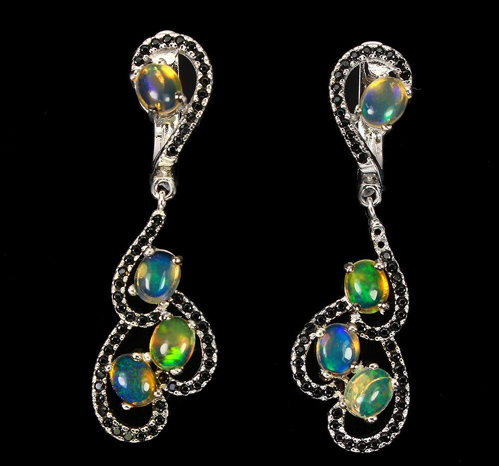 A pair of 925 silver drop earrings set with opals and black spinels, L. 30.4cm.