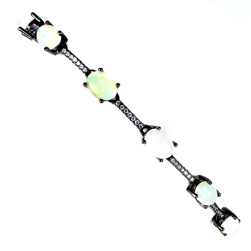 A matching 925 silver bracelet set with cabochon cut opals and white stones, L. 17cm. - Image 2 of 2