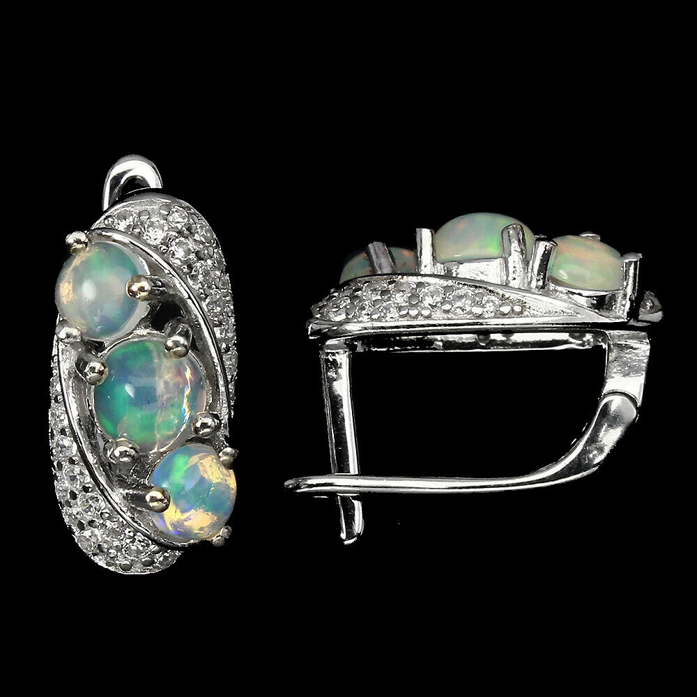 A pair of 925 silver earrings set with cabochon cut opals and white stones, L. 1.6cm. - Image 2 of 2