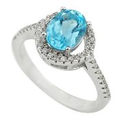 A 925 silver halo ring set with an oval cut blue topaz and white stones, (L).