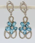 A pair of 925 silver drop earrings set with oval cut topaz and white stones, L. 4cm.