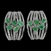 A pair of 925 silver oval cut emerald and white stone set earrings, L. 1.8cm.
