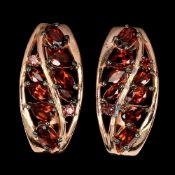 A pair of 925 silver rose gold gilt earrings set with pear and marquise cut garnets and pink