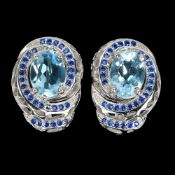 A pair of 925 silver earrings set with oval cut blue topaz and blue stones, L. 1.6cm.