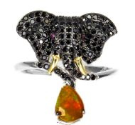 A 925 silver elephant shaped ring set with black spinels, opals and ruby set eyes, (N.5).