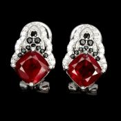 A pair of 925 silver earrings set with cushion cut rubies and black spinels, L. 1.6cm.