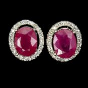 A pair of 925 silver oval cut ruby and white stone set cluster stud earrings, L. 1.1cm.