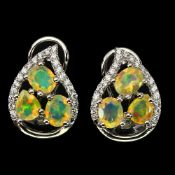 A pair of 925 silver earrings set with oval cut opals and white stones, L. 1.5cm.