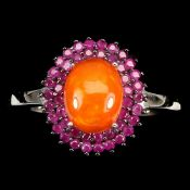A 925 silver cluster ring set with rubies and a cabochon cut fire opal, (O.5).