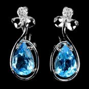 A pair of 925 silver earrings set with large pear cut blue topaz and white stones, L. 2.6cm.