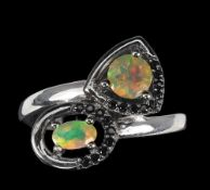A 925 silver crossover ring set with opals and black spinels, (R).