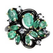 A 925 silver ring set with marquise and oval cut emeralds and white stones, (N).