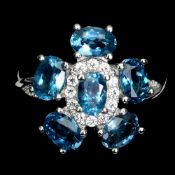 A matching 925 silver flower shaped ring set with London blue topaz and white stones, (N.5).
