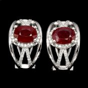 A pair of 925 silver earrings set with oval cut rubies and white stones, L. 1.6cm.