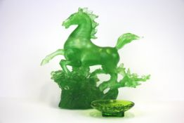 A Chinese frosted glass figure of a Tang horse, H. 19cm. together with a Chinese glass bowl.