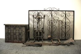 A raw time fire guard with a hammered metal coal box and a quantity of fire side tools.