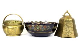 A Japanese Satsuma pottery bowl, Dia. 22cm. together with a Chinese pierced brass hand warmer and an