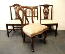 A group of four 18th and 19th Century single hall chairs.