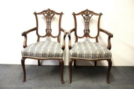 A pair of 19th Century carved beechwood arm chairs.