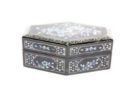 A Chinese lacquer box with Mother of Pearl decoration, L. 13cm. H. 5.5cm.