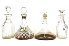 A cut crystal and hallmarked silver mounted decanter with a hallmarked silver presentation label