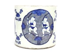 A Chinese hand painted porcelain brush pot with underglaze blue and red decoration with a six