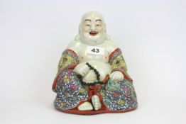 A mid-20th Century Chinese hand enamelled porcelain figure of Putai, H. 20cm.