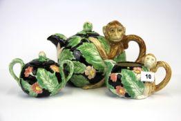 A 1980's Japanese monkey tea set. Teapot H. 16cm.