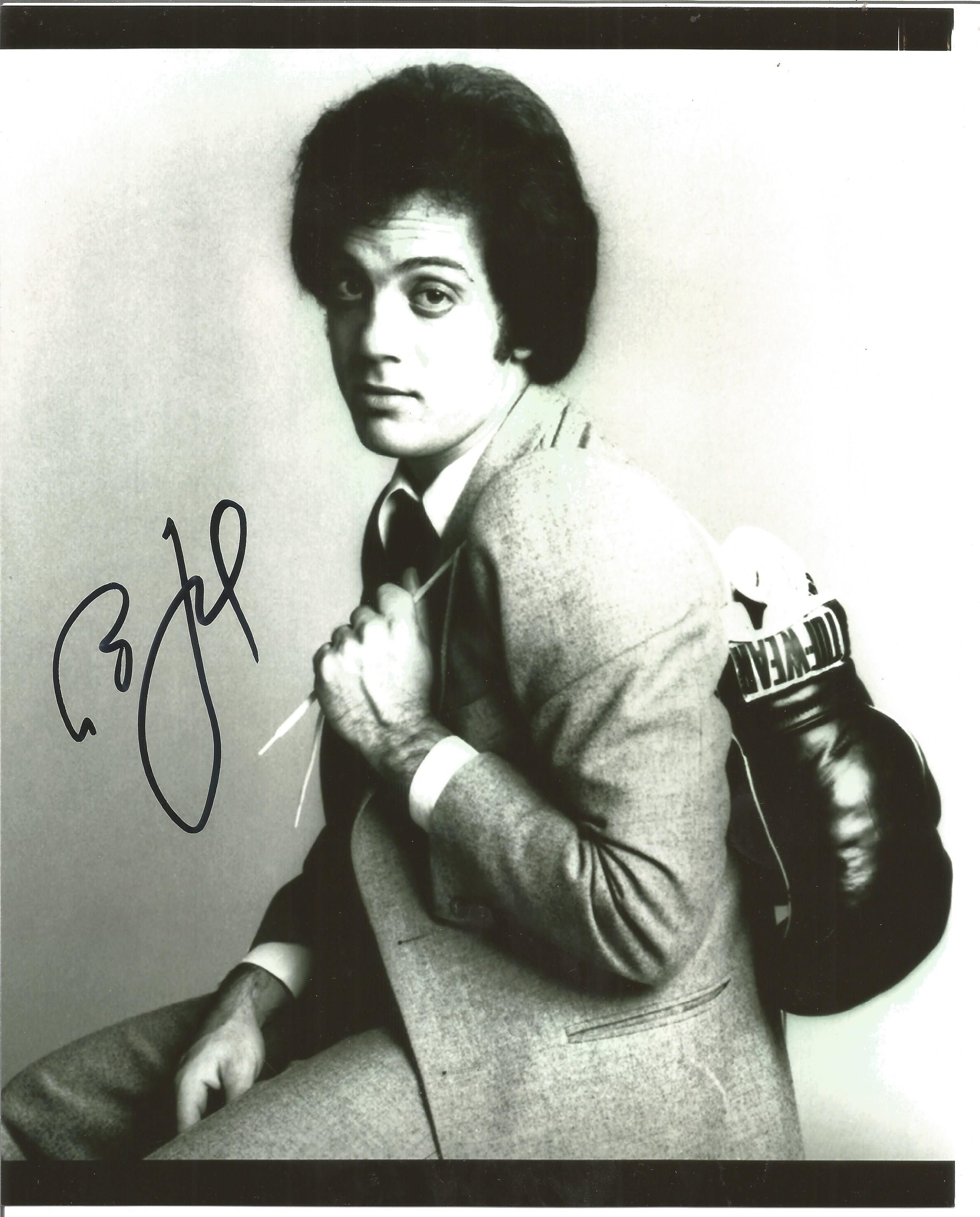 Lot 57 - Music Billy Joel signed 12 x 8 inch bw photo nice early image with boxing gloves over shoulder. Good
