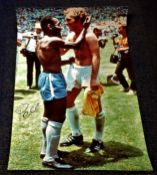Football Pele signed 33x15 colour photo picturing the moment the iconic moment with Booby Moore