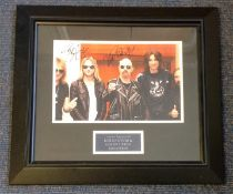 Judas Priest signed colour photo mounted and framed to approx size 18x16. Signed by Rob Halford